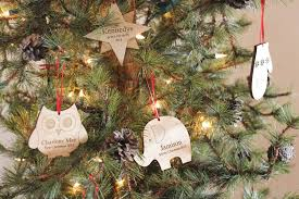 blank ornaments to personalize personalized baby s christmas footprint ornament smiling tree
