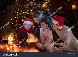 christmas night near christmas tree lovely stock photo 509096707