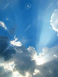sun shining through clouds in the sky stock photo picture and