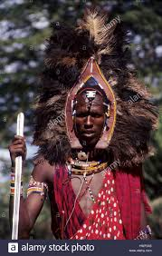 masai warrior with traditional ostrich feather headress ornament