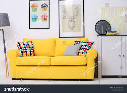 yellow sofa living room stock photo 401538130 shutterstock yellow sofa in the living room