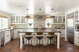 pink kitchen canisters beige tile backsplash white wicker bar stools transitional dallas