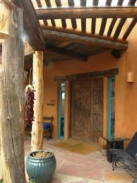 southwestern style patio with rough wood columns vitas stucco