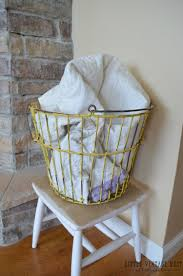 baskets for home decor farmhouse style decorating with wire baskets little vintage nest