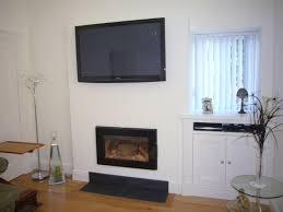 storage under the small window design idea beside wall mounted tv