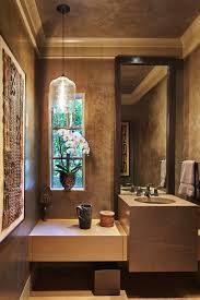 stuart silk architects and the dream team transform a family the lower level powder room has hand painted venetian plaster a light designed
