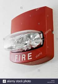 Red Fire Alarm With Strobe Light Mounted On A Wall As Part Of A Fire