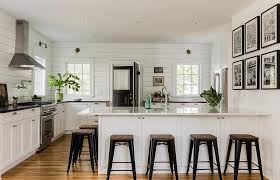 white kitchen with black stove and hood transitional kitchen