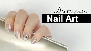 beige and nails with white stripes autumn nail art video tutorial