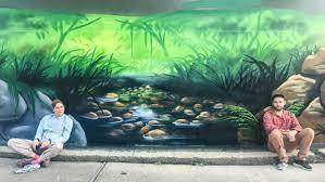 photo gallery street art mural gives new life to mt riverview scott nagy left and janne birkner aka krimsone take a break while
