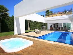 a modern fully equipped house with an swimming pool that is lit