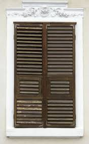 vintage window with wooden blinds and wall ornament free