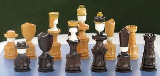 a few chess pieces by paul fletcher made on the ornamental lathe