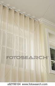 stock photo of window treatments hidden curtain rod sheer