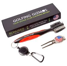 red brush cleaner divot tool with us flag ball marker golfing