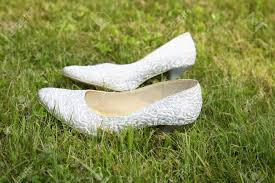 wedding shoes for grass white wedding shoes on a green grass stock photo picture and