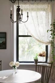Hanging Lace Curtains The Dishtowels The Plant Hanging From The Curtain Rod The