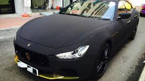 matte black and pink bmw maserati ghibli with matte black suede wrap looks striking