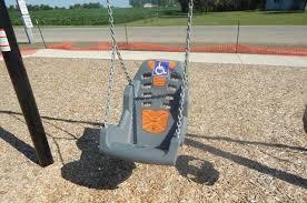 handicap swing oakwood celebrates handicap accessible playground wdan am