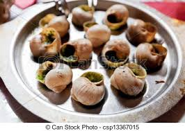 escargot cuisine escargots plate of escargot shells with special tongs and stock