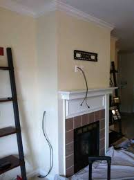 Tv Mount Over Fireplace by Concealing Wires In The Wall Over The Fireplace Before The Tv Is