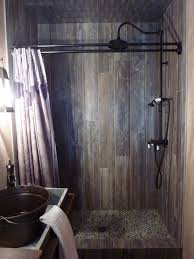 Small Bathroom Designs With Walk In Shower Cool Wood Grain Porcelain Shower And River Rocks Stephen Belyea