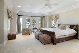 Relaxing Master Bedroom by Master Bedroom In Luxury Home With Lake View Stock Photo Picture
