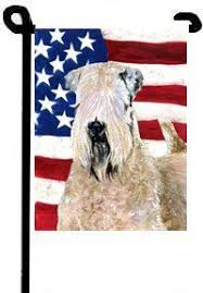 just begging for a home this wheaten terrier ornament has puppy