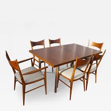 paul mccobb irwin group walnut dining table and six chairs by