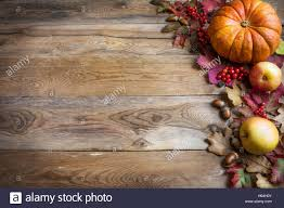 thanksgiving or fall greeting with orange pumpkins and fall leaves