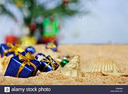 ornaments in the sand blue packages stock photo