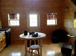 small scale homes wood tex 768 square foot prefab cabin living dining kitchen area