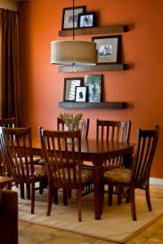 orange design ideas gold sunburst mirror orange walls and
