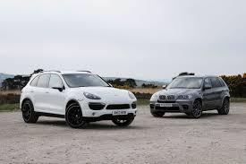 porsche cayenne vs bmw x5 porsche cayenne s diesel vs bmw x5 m50d auto express