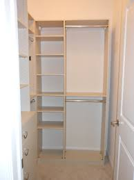l shaped white wooden closet having white wooden shelves and