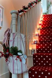 pe094 07 christmas decorations in bag on banister of narratives