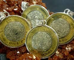 four aztec sun god coin pendants co 1471