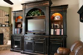 large traditional wood black entertainment center with arched