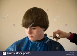 pictures of hair cut for year a 14 year old boy gets a haircut stock photo royalty free image