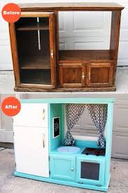 tv cabinet kids kitchen before after turn an old cabinet into a kid s kitchen diy