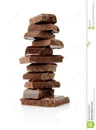 pile of blocks of chocolate on white background stock photo