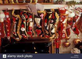 a long row of festively decorated christmas stockings hang by a