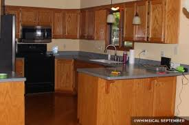 oak kitchen cabinets painted grey painting kitchen cabinets before after