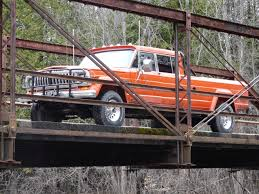 lowered jeep wagoneer on the bridge in mesick jeep j20 crew cab truck pinterest