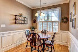 dining room with hardwood floors built in bookshelf in
