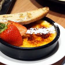 delicious vanilla bean creme brulee with almond biscotti and