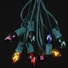 assorted transparent c7 outdoor string light set on green wire