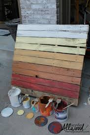 an ombre painted pallet for fall decorations on your front porch