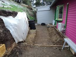 how to build an earthship retaining wall good life permaculture