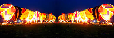 glow in the balloons glow hot air balloons mirror image photograph by